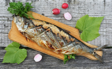 Grilled herring, radishes and parsley on a cutting Boards close