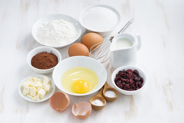 fresh ingredients for baking on a white table, top view