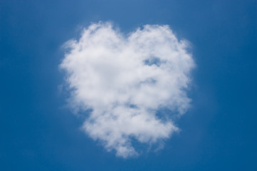 Heart shaped clouds on the blue sky.