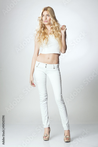"Beautiful blond woman in white pants and belly shirt"" Stock photo ..."