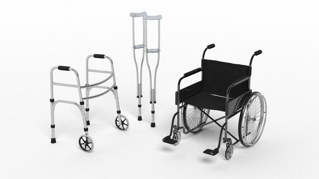 Black disability wheelchair crutch and metallic walker isolated