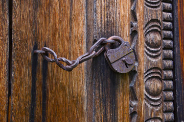 the old lock on the forged chain