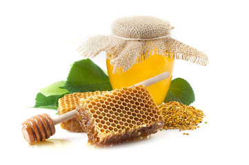 A jar of honey, honeycomb with pollen.