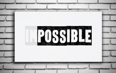 Impossible word on white board over white brick wall