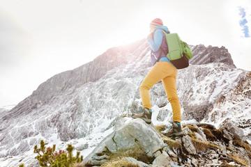 Girl on mountain ledge