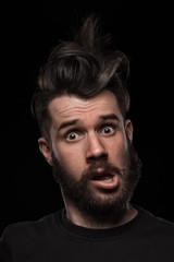 Portrait of young crazy man in studio