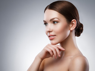 Young woman with beautiful face and soft skin