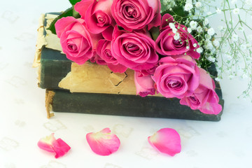 bouquet of pink roses on old books floral background is love tenderness vintage retro selective soft focus