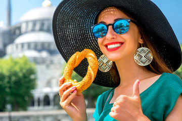 Woman with turkish bagel in Istanbul