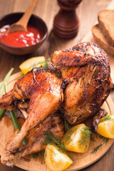 Grilled chicken on wooden plate