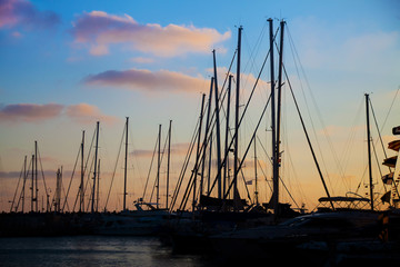 Silhouettes of yachts in a bay at sunset