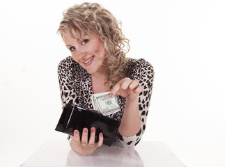 Young woman holding dollars in her wallet