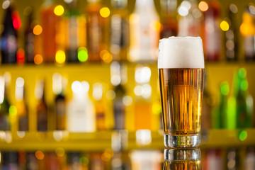 Jug of beer served on bar counter