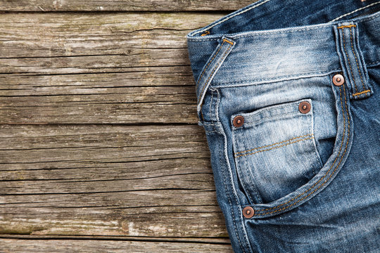 Jeans on wooden background