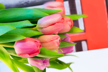 bouquet of tulips flowers on a drawing background vintage retro selective soft focus toned photo