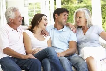 Portrait Of Mature Parents Relaxing With Grown Up Children