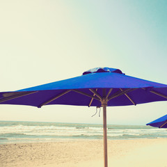 Retro beach with blue umbrella