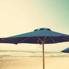 Retro beach with blue umbrellas