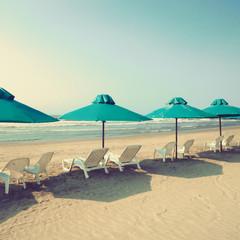 Retro beach with green umbrellas