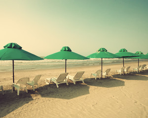 Retro beach with green umbrellas