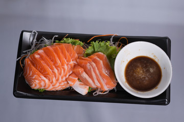 Raw salmon in the dish.