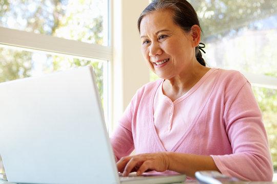 Senior Taiwanese woman working on laptop