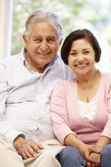 Senior Hispanic couple at home