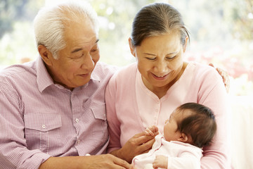 Asian grandparents with baby