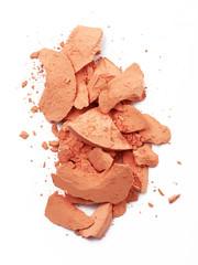 Face make up powder cracked on background
