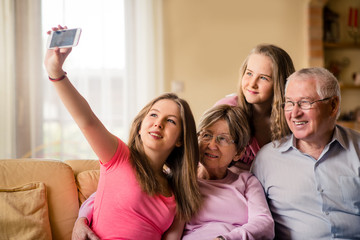 Grandparents with grandchildren selfie