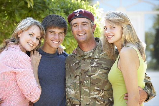 Portrait Of Soldier Returning Home WithTeenage Family