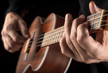 hands playing ukulele