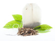 Tea bag with leaves isolated on white background