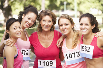 Group Of Female Athletes Competing In Charity Marathon Race