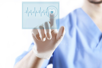 Doctor pressing virtual button with heart diagram