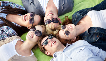 group of students or teenagers lying in circle