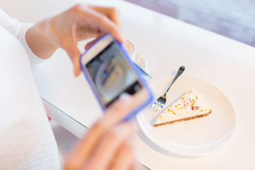 woman hands with smartphone taking food picture