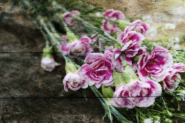 Exposure of pink flowers,wood texture background.
