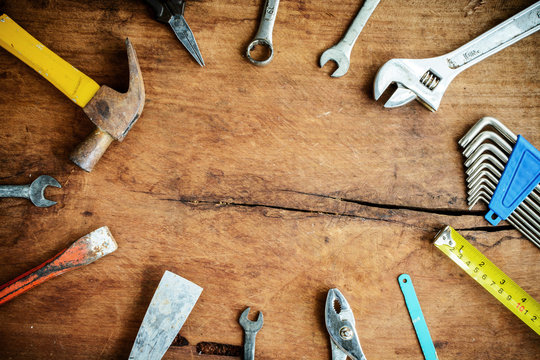 Set of work tools on old grunge wooden background