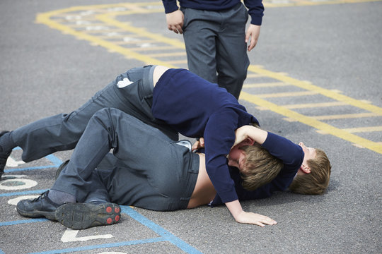 Two Boys Fighting In School Playground