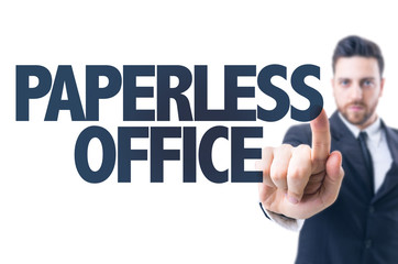 Business man pointing the text: Paperless Office