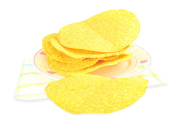 tostada corn tortilla shells on white background