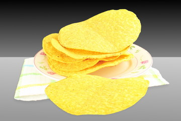 tostada corn tortilla shells on black white  background