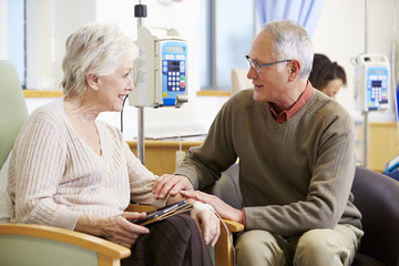 Senior Woman With Husband During Chemotherapy Treatment