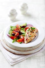 Grilled chicken fillet with cherry tomato salad