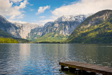 Mountain reflection in Alpine lake in Hallstatt village