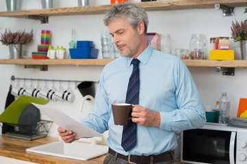 Man checking document at home