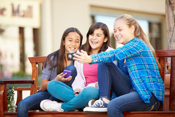 Group Of Girls Taking Selfie On Mobile Phone