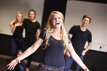 Students Taking Singing Class At Drama College Fotobehang