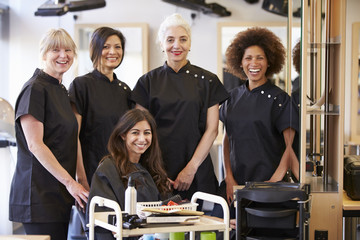 Teacher Helping Mature Students In Hairdressing
